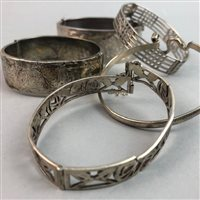 Lot 4-A LOT OF FOUR SILVER BANGLES AND ONE OTHER