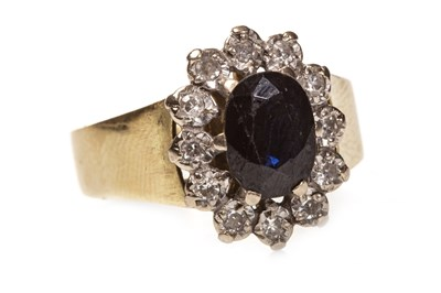 Lot 218 - A BLUE GEM AND DIAMOND SET CLUSTER RING