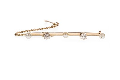 Lot 1-AN EDWARDIAN DIAMOND AND PEARL SET BAR BROOCH