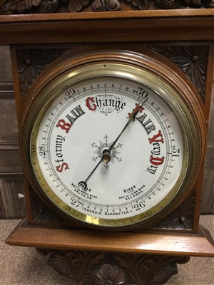 Lot 1406-A LATE VICTORIAN OAK ANEROID BAROMETER