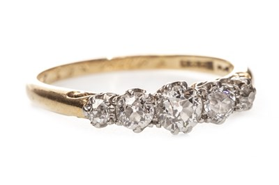 Lot 21-AN EARLY 20TH CENTURY DIAMOND FIVE STONE RING
