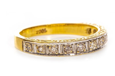 Lot 110-AN EARLY TO MID TWENTIETH CENTURY DIAMOND HALF ETERNITY RING
