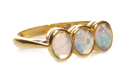 Lot 89 - AN EARLY 20TH CENTURY OPAL THREE STONE RING