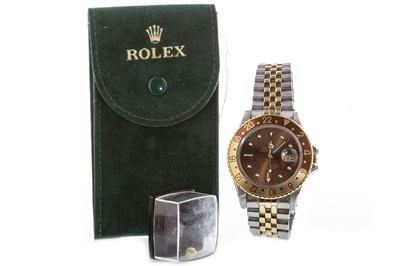 Lot 777-A GENTLEMAN'S ROLEX GMT MASTER ROOT BEER WATCH