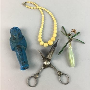 Lot 1-AN EGYPTIAN FIGURE, CANDLE SNUFFER, GREEN HARDSTONE AND ENAMEL FLOWER AND BEADS