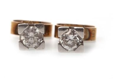 Lot 117-A PAIR OF DIAMOND STUD EARRINGS