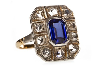 Lot 9-AN ART DECO DIAMOND AND BLUE GEM RING