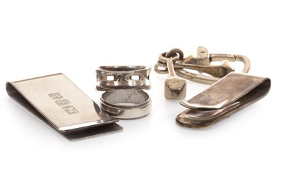 Lot 127 - TWO SILVER RINGS, TWO SILVER MONEY CLIPS AND A KEYRING