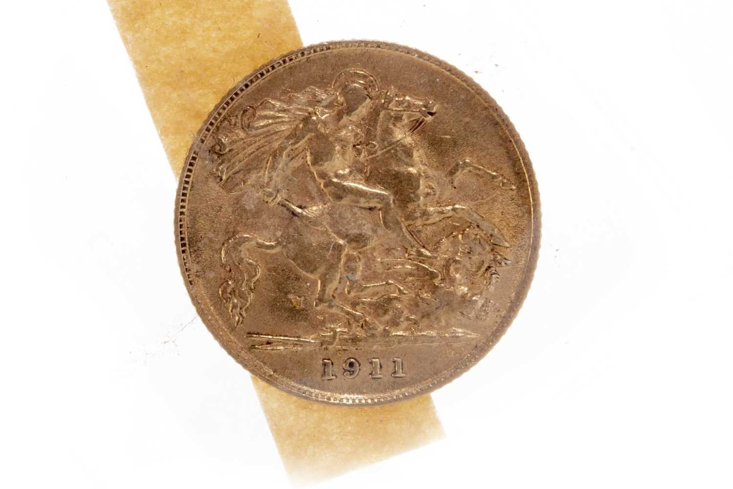 Lot 521-A GOLD HALF SOVEREIGN, 1911