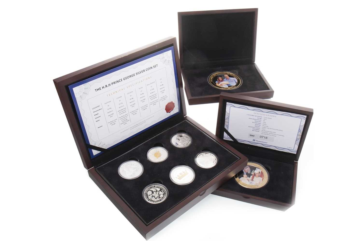 Lot 529-THREE ROYAL INTEREST COIN SETS