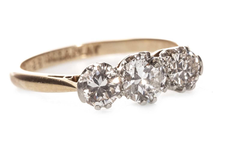 Lot 46 - A DIAMOND THREE STONE RING