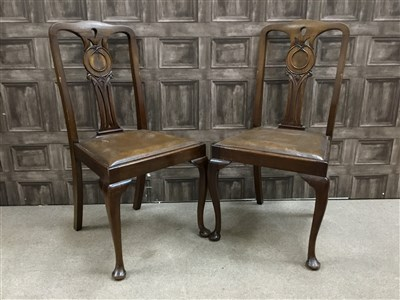 Lot 909-AN EARLY 20TH CENTURY MAHOGANY DINING ROOM SUITE