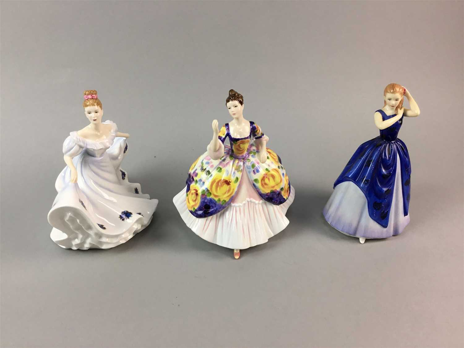 Lot 11-A LOT OF THREE ROYAL DOULTON FIGURES