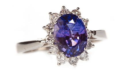 Lot 207 - A PURPLE SAPPHIRE AND DIAMOND CLUSTER RING