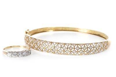 Lot 18-A DIAMOND BANGLE AND A GEM SET RING