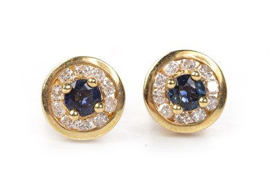 Lot 19-A PAIR OF BLUE GEM AND DIAMOND EARRINGS