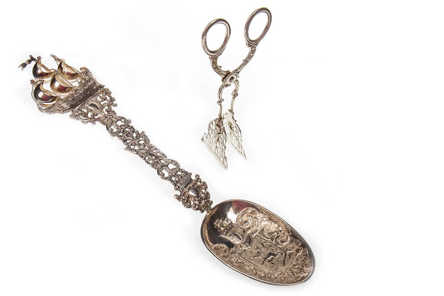 Lot 804-A CONTINENTAL SILVER ANOINTING SPOON WITH A PAIR OF SUGAR NIPS