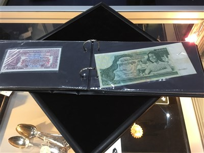 Lot 29-AN ALBUM OF CHIEFLY FOREIGN BANK NOTES