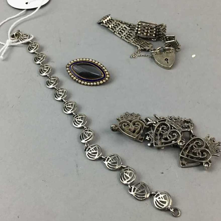 Lot 5-AN ENAMELLED SEED PEARL SET MOURNING BROOCH AND THREE BRACELETS