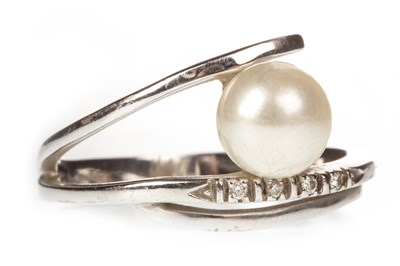 Lot 50-A PEARL AND DIAMOND SET RING