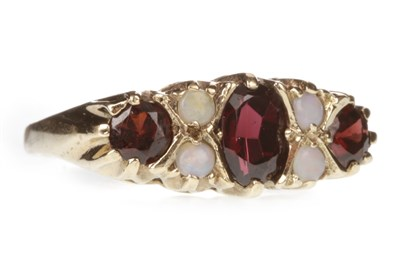 Lot 139-A RED GEM SET AND OPAL RING