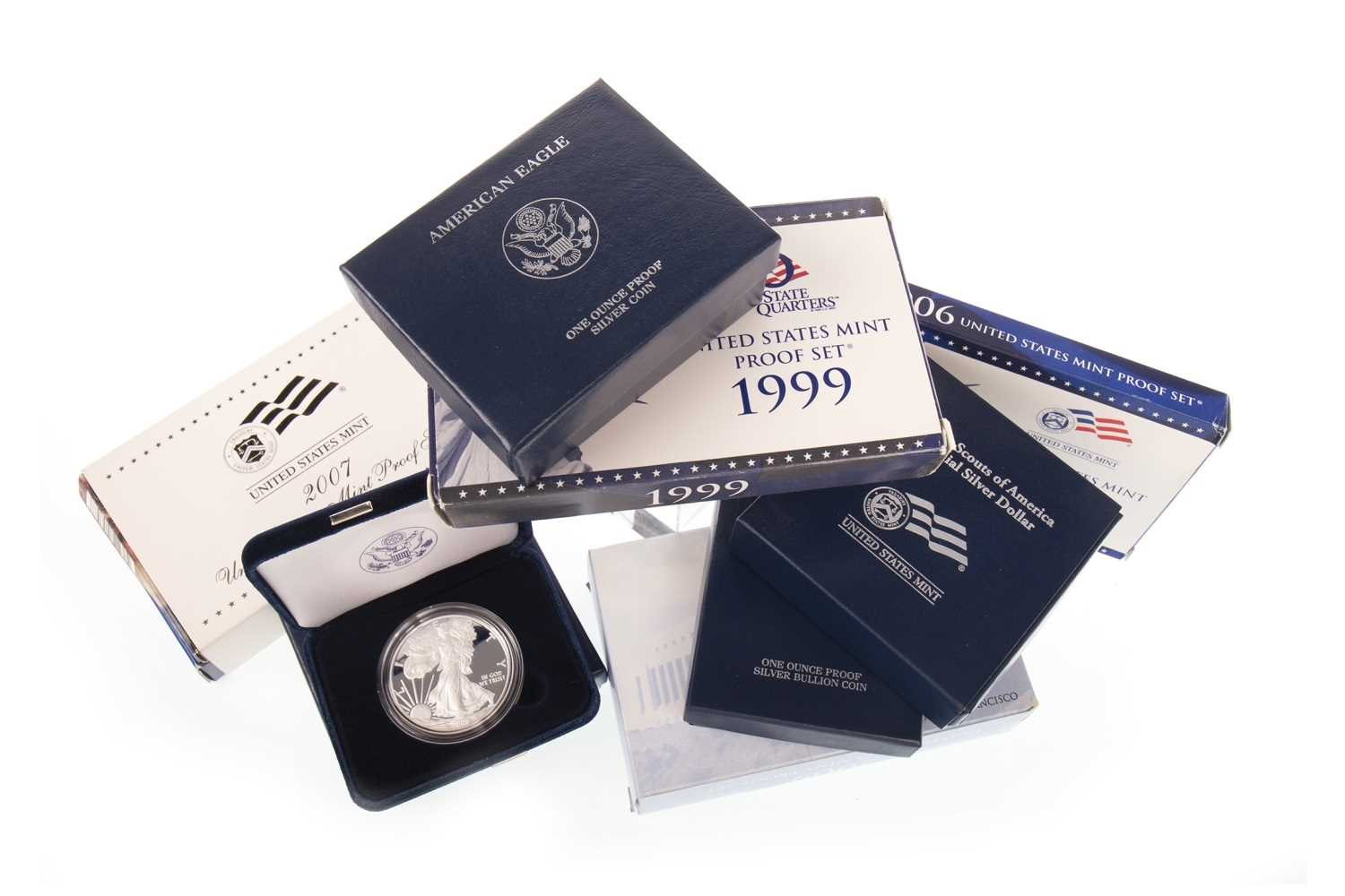 Lot 577-EIGHT USA SILVER COINS AND COLLECTIBLE COIN SETS