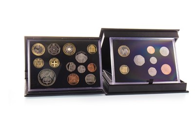 Lot 584-TWO COIN SETS