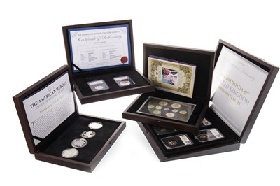 Lot 585-TWO SILVER COIN SETS AND TWO OTHER COIN SETS