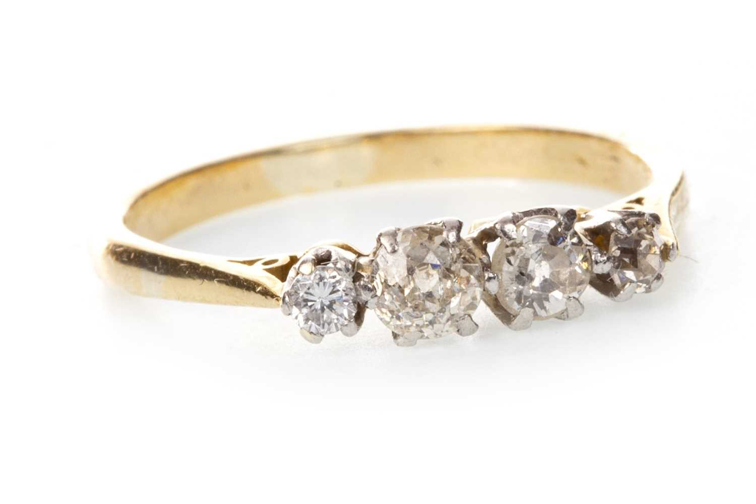 Lot 85-A DIAMOND FOUR STONE RING