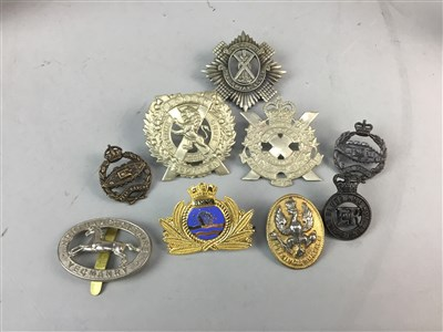 Lot 5-A COLLECTION OF MILITARY CAP BADGES AND A MEDAL