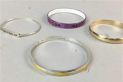 Lot 7-A SILVER ENAMELLED BANGLE AND THREE OTHER BANGLES