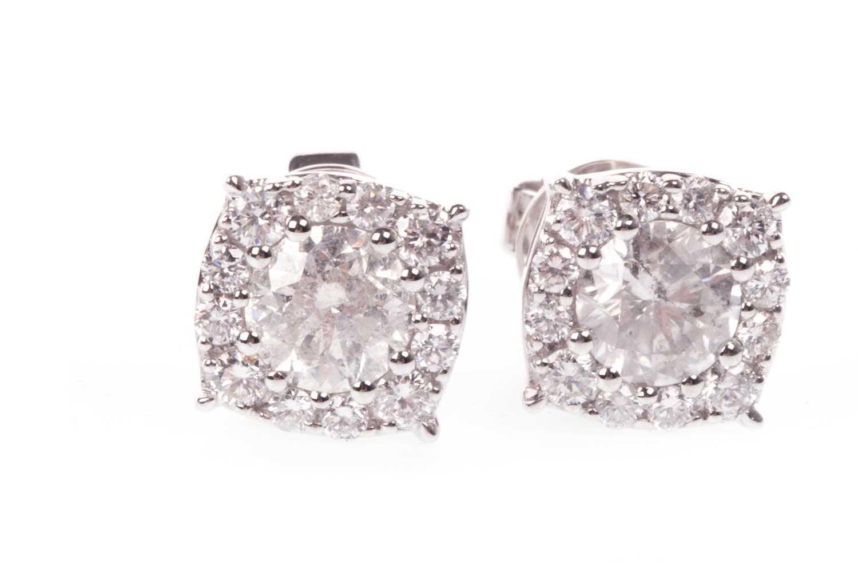 Lot 60-A PAIR OF DIAMOND CLUSTER EARRINGS