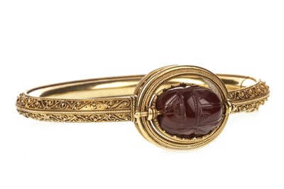 Lot 84-AN ARCHAEOLOGICAL REVIVAL SCARAB BEETLE MOTIF BANGLE
