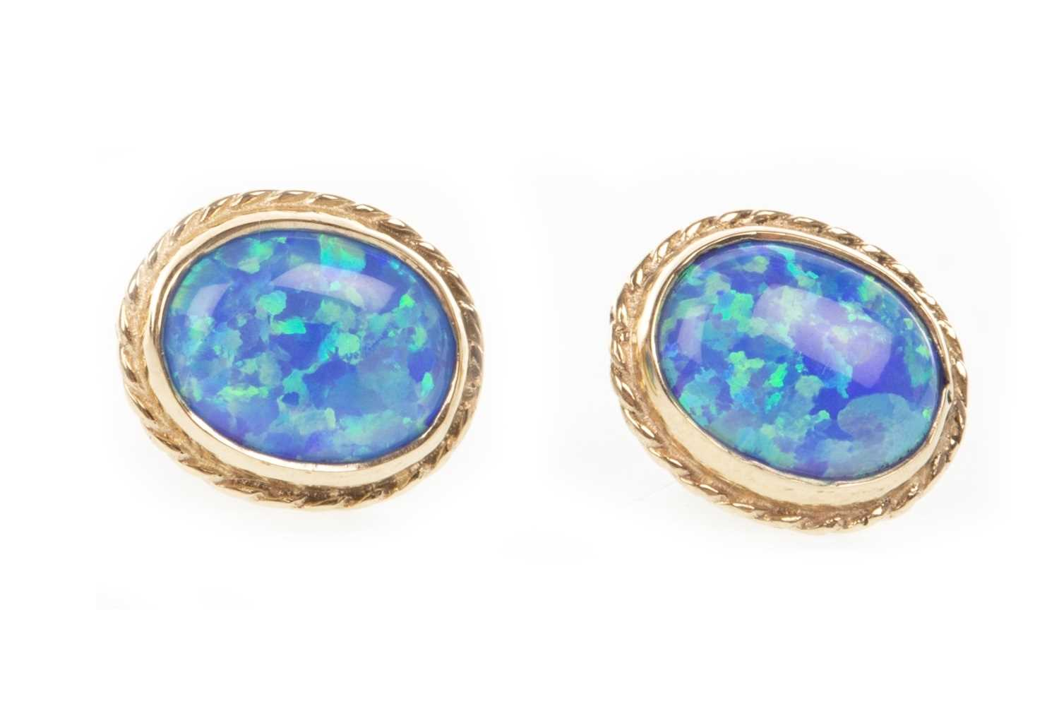 Lot 140-A PAIR OF GEM SET STUD EARRINGS