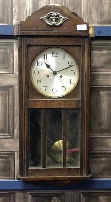 Lot 58-AN OAK CASED WALL CLOCK