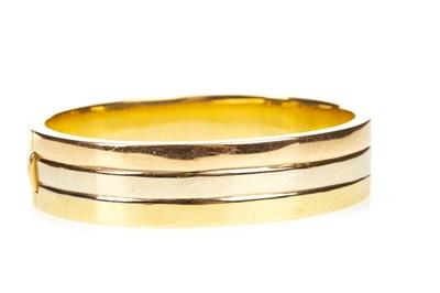 Lot 52-AN EIGHTEEN CARAT GOLD BANGLE
