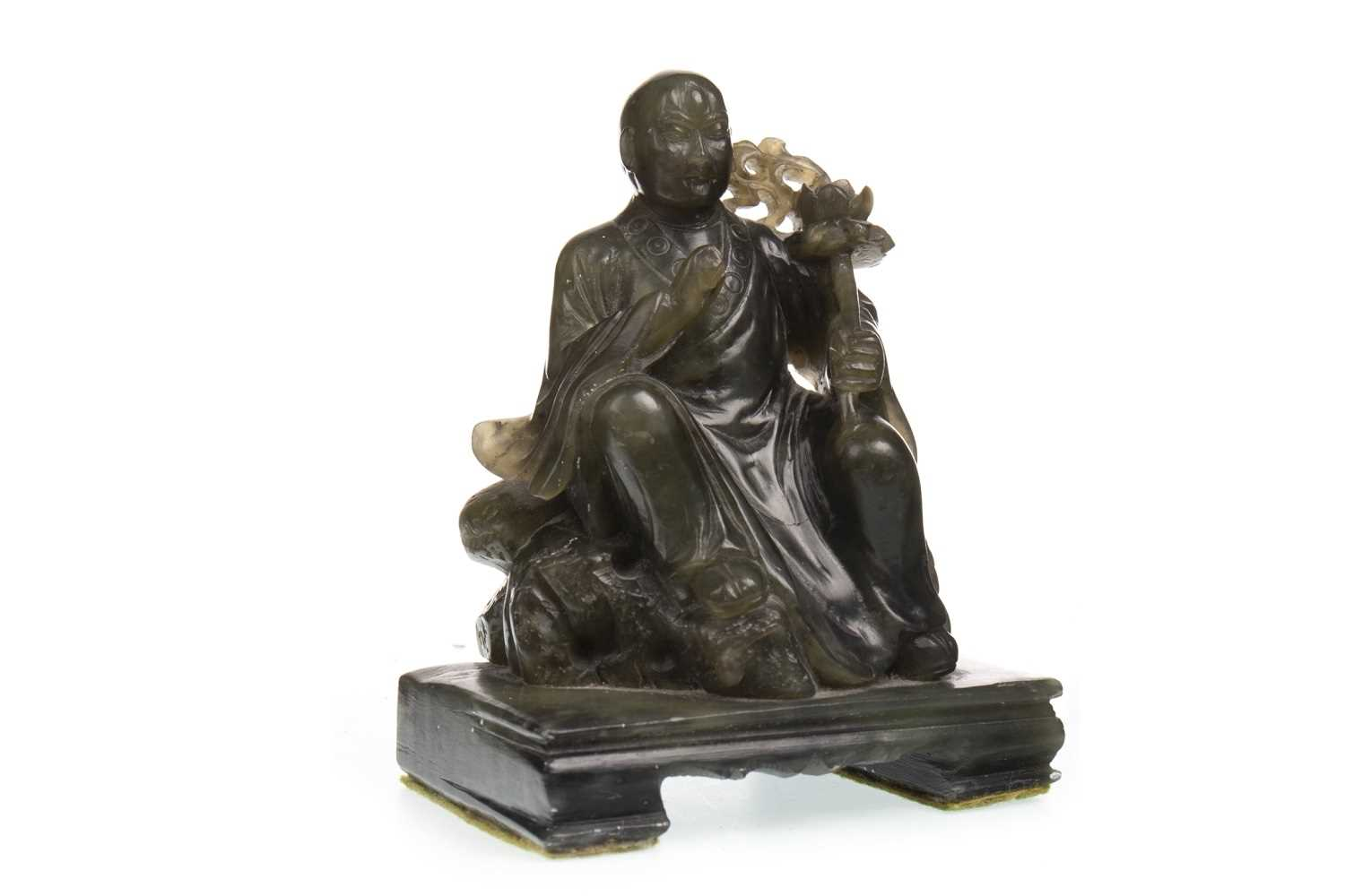 Lot 1003-AN EARLY 20TH CENTURY CHINESE GREEN JADE BUDDHA