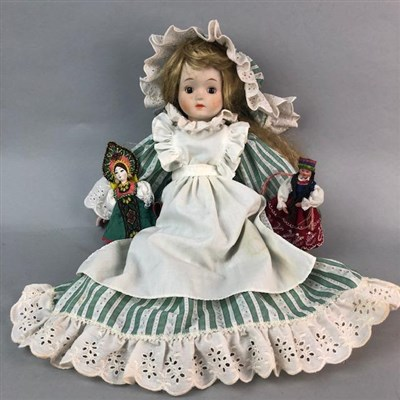 Lot 39-AN EARLY 20TH CENTURY BISQUE HEADED DOLL AND OTHER DOLLS