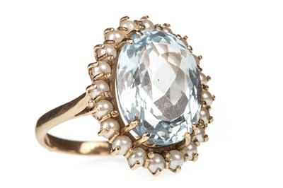 Lot 47-A BLUE GEM AND PEARL RING
