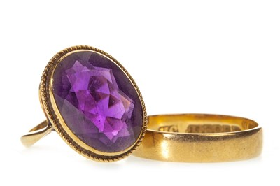 Lot 30-AN AMETHYST RING AND A WEDDING BAND