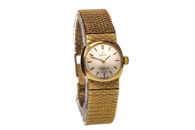 Lot 775-AN OMEGA LADYMATIC GOLD WATCH