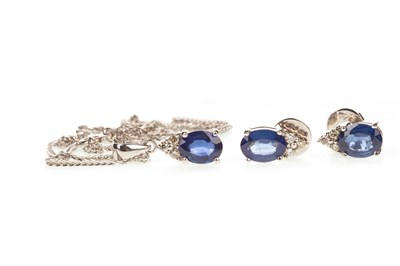 Lot 22-A BLUE GEM AND DIAMOND PENDANT WITH MATCHING EARRINGS