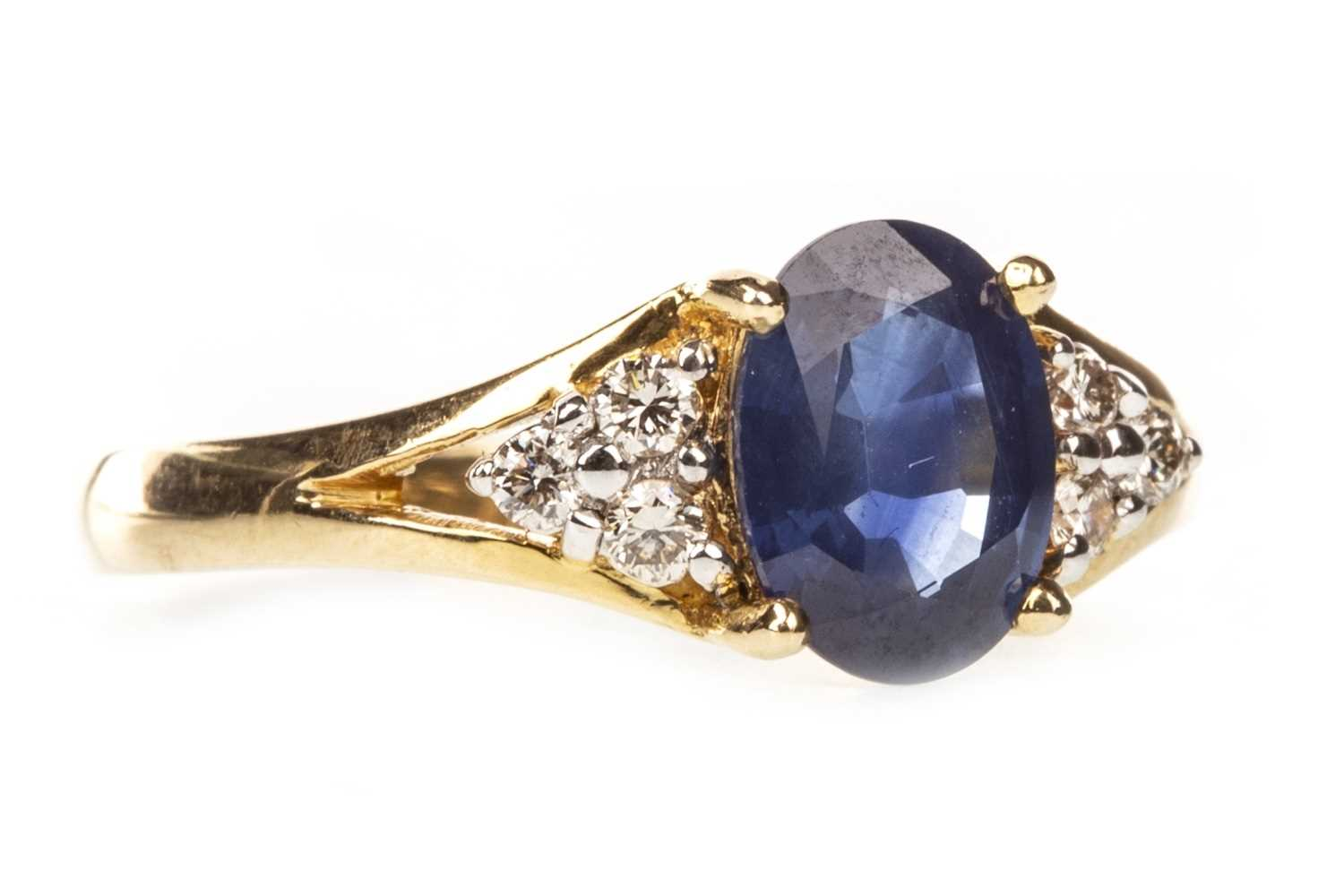 Lot 12-A BLUE GEM AND DIAMOND RING