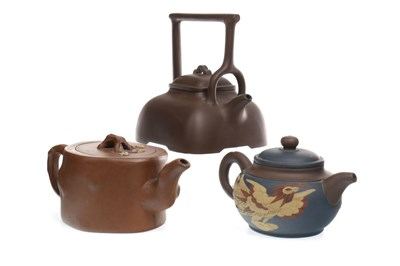 Lot 1133-A LOT OF THREE 20TH CENTURY CHINESE YI XING TEA POTS