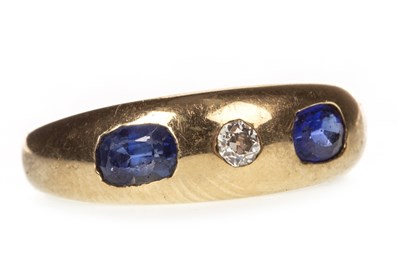 Lot 66-AN EARLY TWENTIETH CENTURY DIAMOND AND GEM SET RING