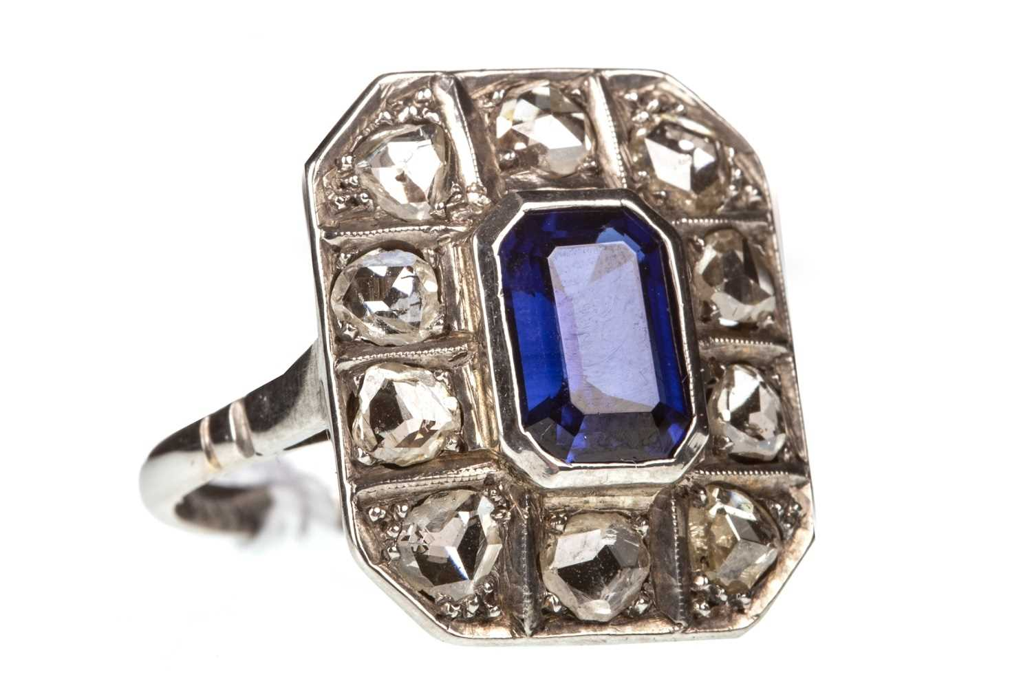 Lot 13-AN ART DECO DIAMOND AND BLUE GEM RING