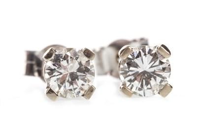 Lot 7-A PAIR OF DIAMOND STUD EARRINGS