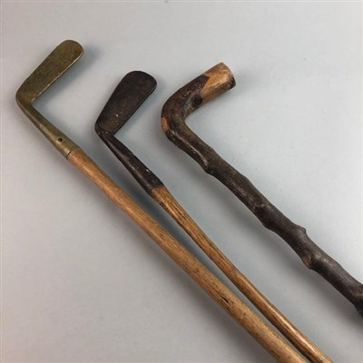 Lot 19-A PUTTER BY J. ANDERSON OF PUTTER, ANOTHER PUTTER AND A WALKING STICK