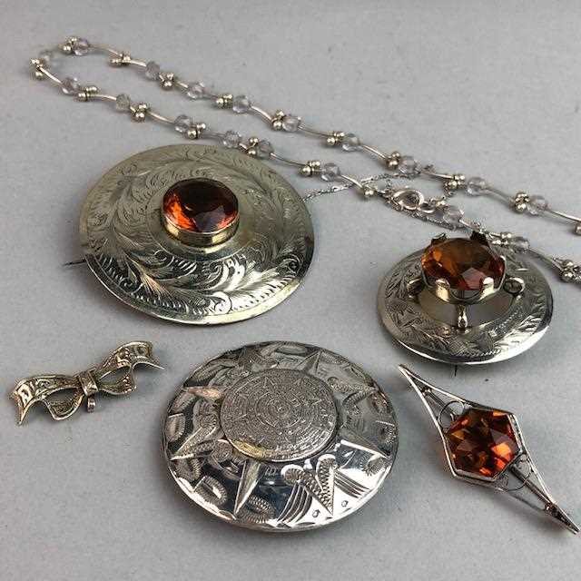 Lot 7-A LOT OF SILVER AND PLATED BROOCHES
