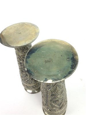 Lot 1025-A PAIR OF EASTERN SILVER CANDLESTICKS